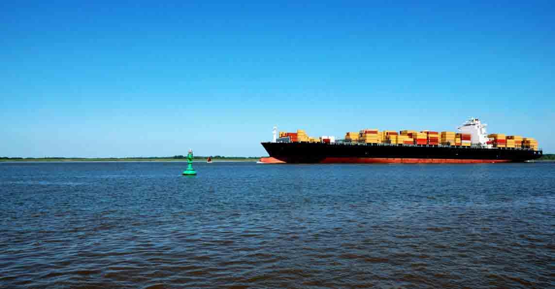 Cargo ship sailing across water