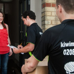 Kiwi Movers staff at the door with customer