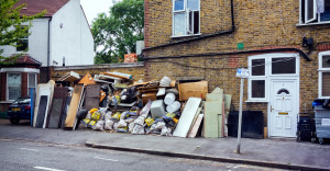 pile of rubbish on the side of the street