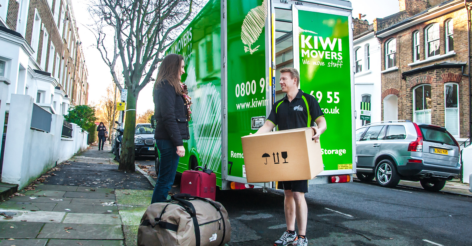 Regan Outside Removal Van Helping Mover with Suitcases
