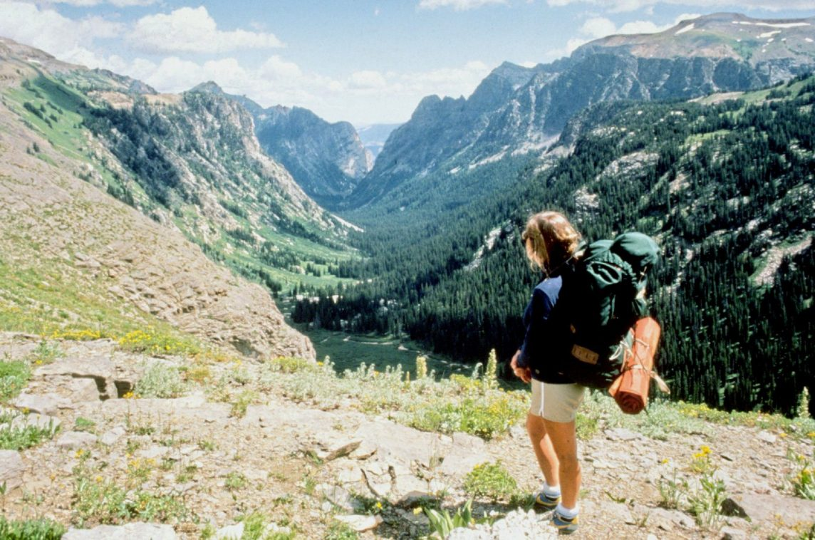 Woman backpacking in hills